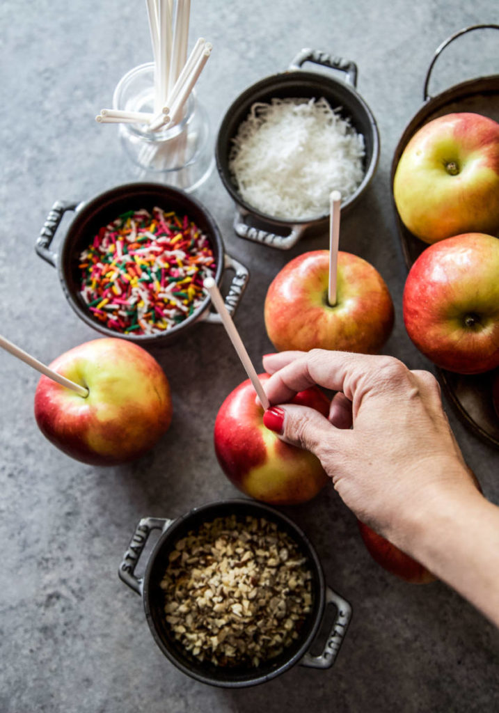 A photo of caramel apples diy a hand making caramel apples