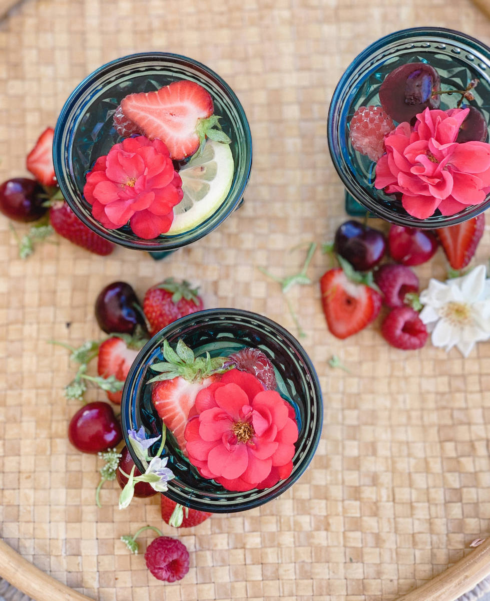 white wine sangria with cherries, strawberries, and raspberries