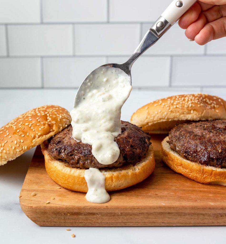 smokey blue cheese sauce on wagyu beef burgers