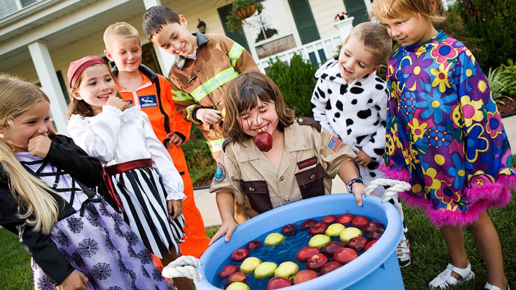 fall birthday ideas image - children bobbing for apples
